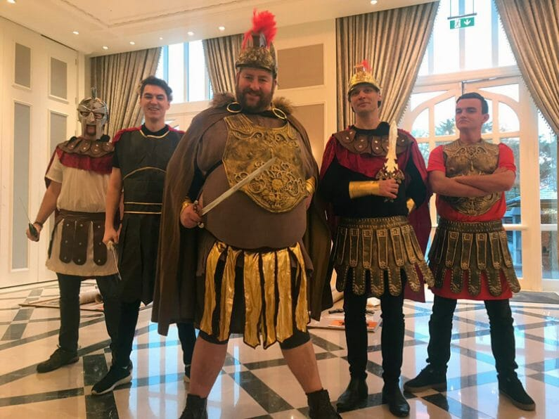 Orangeworks team dressed as Roman emperors, ready to brief delegates who are doing the flat out chariot challenge.
