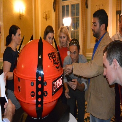 Delegates of Red Alert, an escape room style team building game run by Orangeworks, standing at the red sphere.