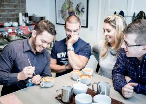 delegates learning latte art during a team building activity in dublin in the Dublin Barista School