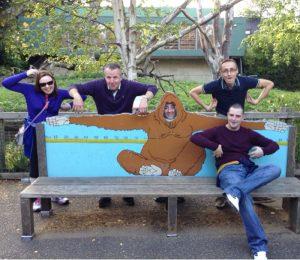 A group posing like monkeys at the Dublin Zoo during Orangeworks treasure hunt game.