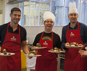 3 men posing with their food they cooked during the team building activity in dublin ran by Cooks Academy.