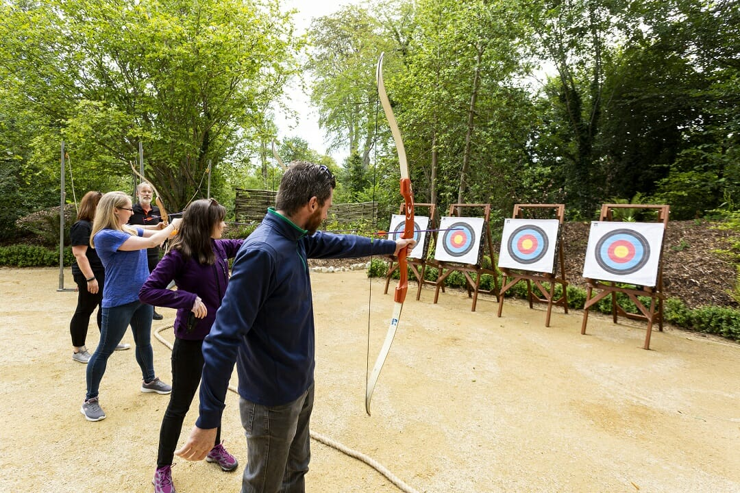 Delegates doing archery at Druids Glen, hosted by Orangeworks, the team building & adventure activities company.
