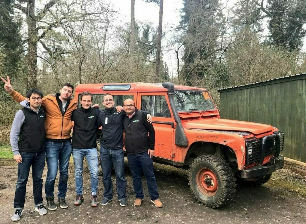 Delegates standing in front of an Orangeworks landrover at the Off-road driving track at Carton House.