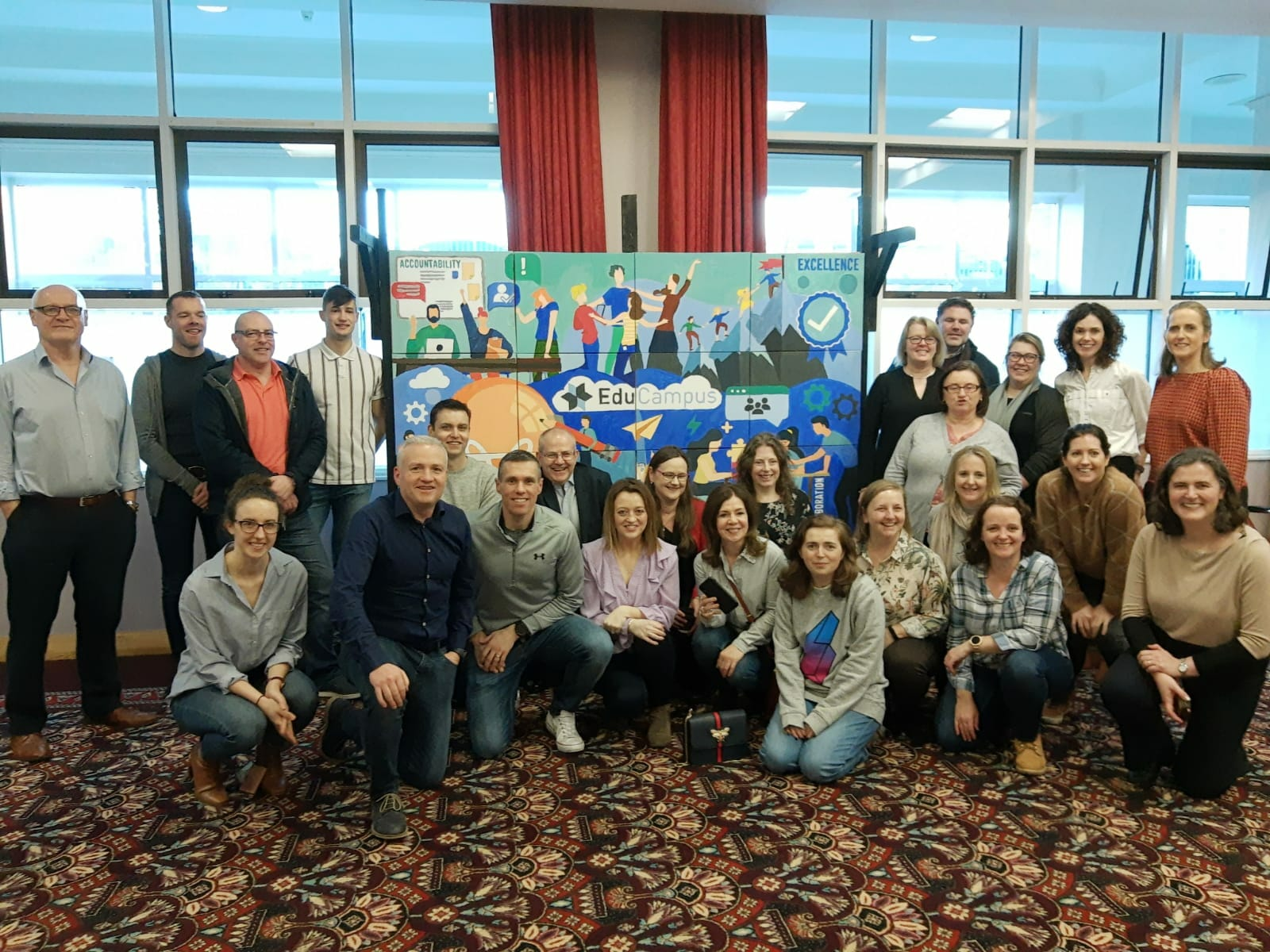 Employees of EduCampus who painted their big picture canvas during their team building day with orangeworks.