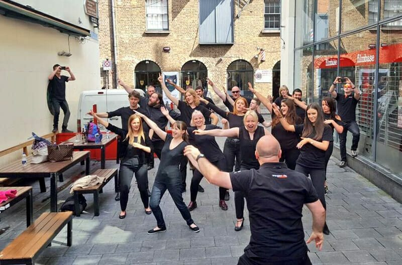 Delegates having fun dancing together during their team bonding game Commercial Break with Orangeworks.