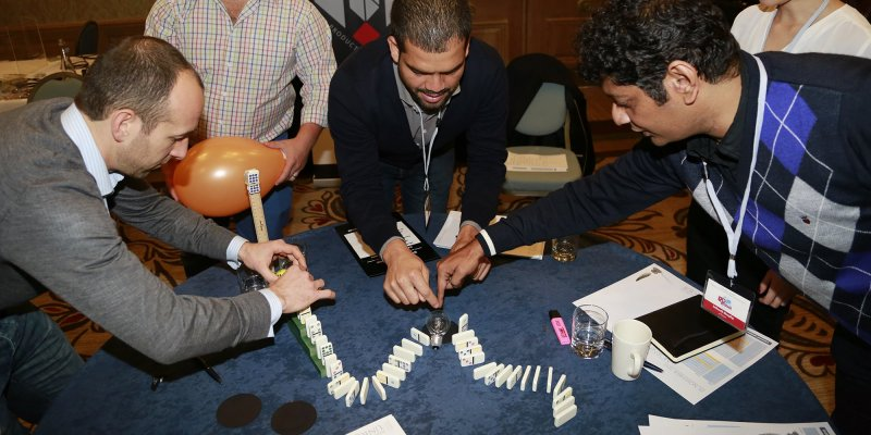 Delegates enjoying their corporate day out playing Domino Effect together.