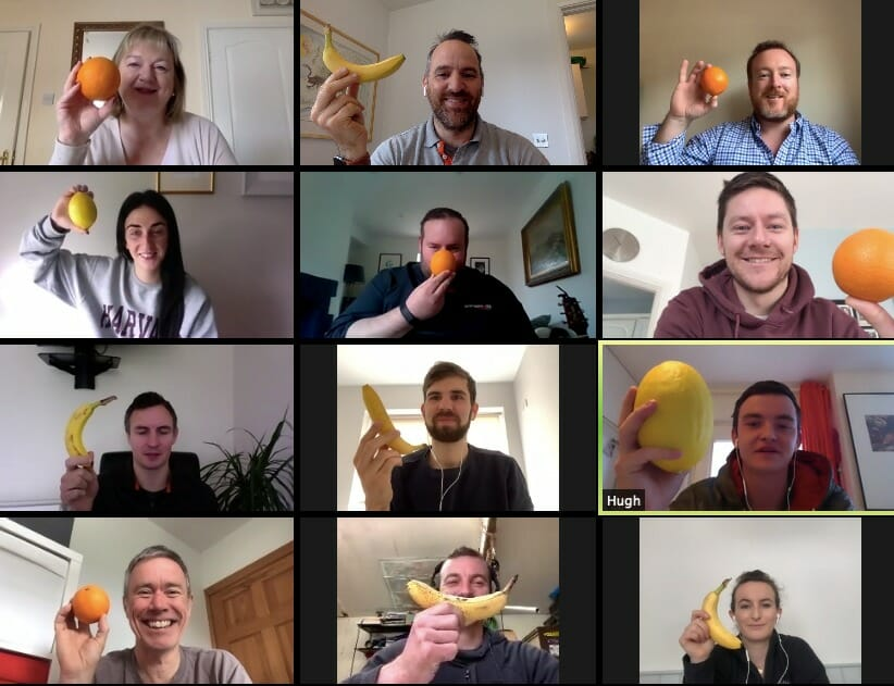 A remote team playing Knowing Go Remote; one of Orangeworks online games for virtual teams.