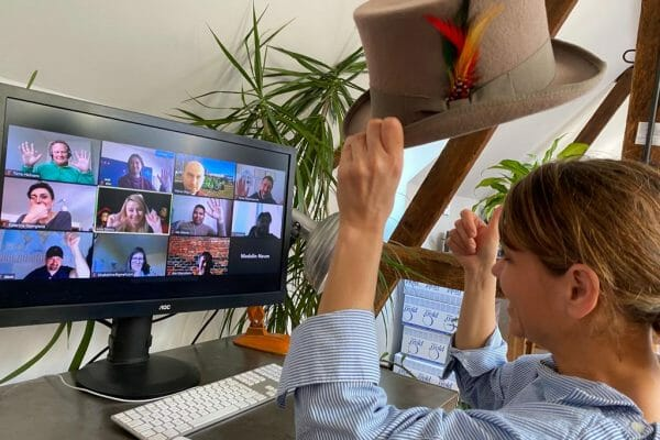 A delegate playing one of Orangeworks icebreakers for remote teams with her colleagues on Zoom.