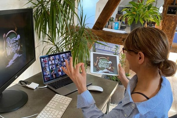 A delegate playing one of Orangeworks online team building activities called 'Race Around the World' with her remote team.