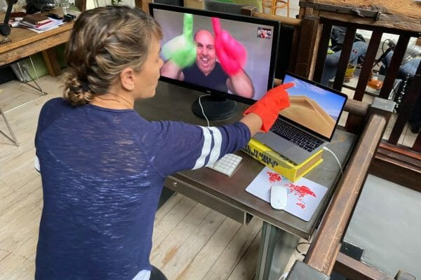 Delegate playing Orangeworks remote team building game called Body Rap, on Zoom with her remote working team.