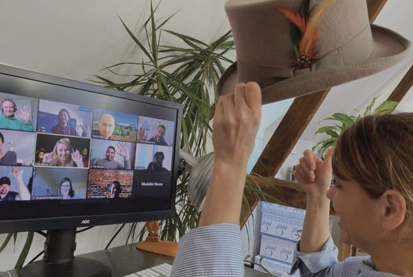 Mary engaging in one of Orangeworks remote team icebreakers with her colleagues on their Zoom video meeting.