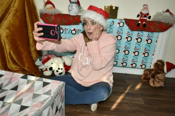 A delegate taking a selfie with her Christmas decorations as she plays Christmas Blockbusters on Location with Orangeworks.