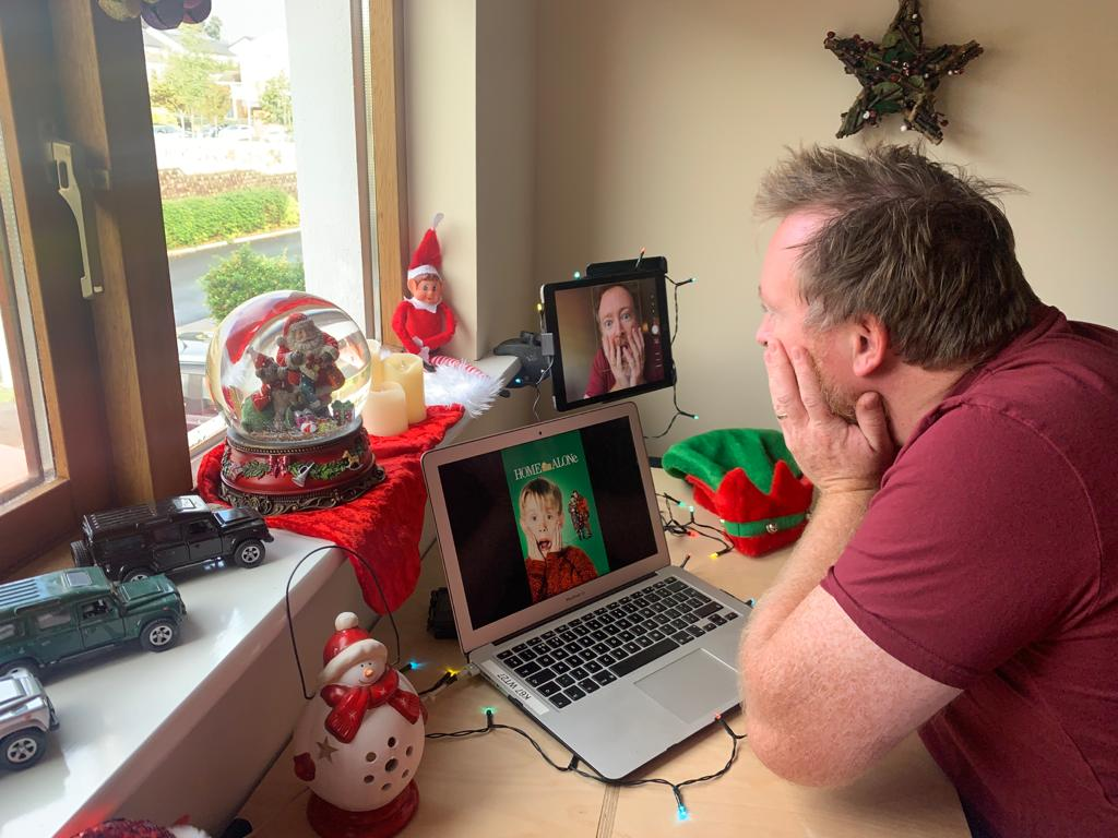 Delegate taking selfies and recreating famous Christmas movie photos during Orangeworks game A Picture Perfect Christmas.