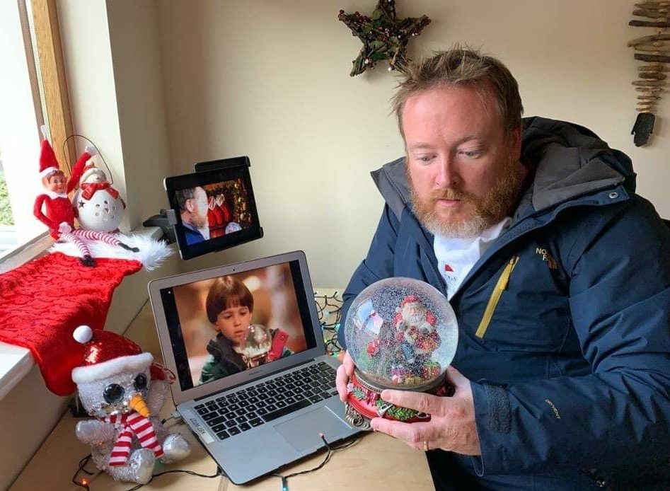 Delegate taking selfies and recreating famous Christmas photos during his virtual staff Christmas party with Orangeworks.