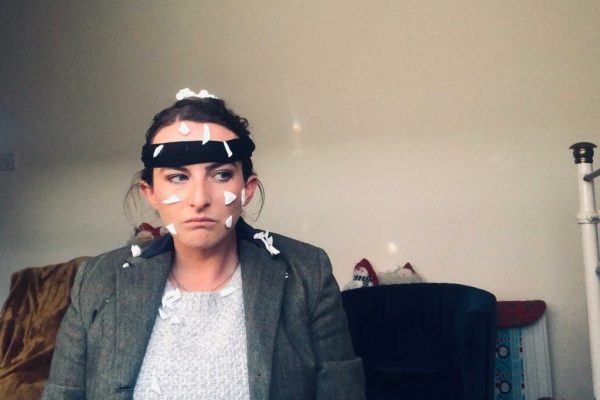 Fiona dressed up as Harry from Home Alone during one of Orangeworks virtual work Christmas party games.