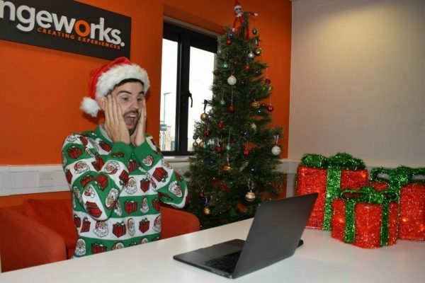 Delegate looks shocked at his laptop while playing Orangeworks virtual murder mystery game called Who Stole Santa.
