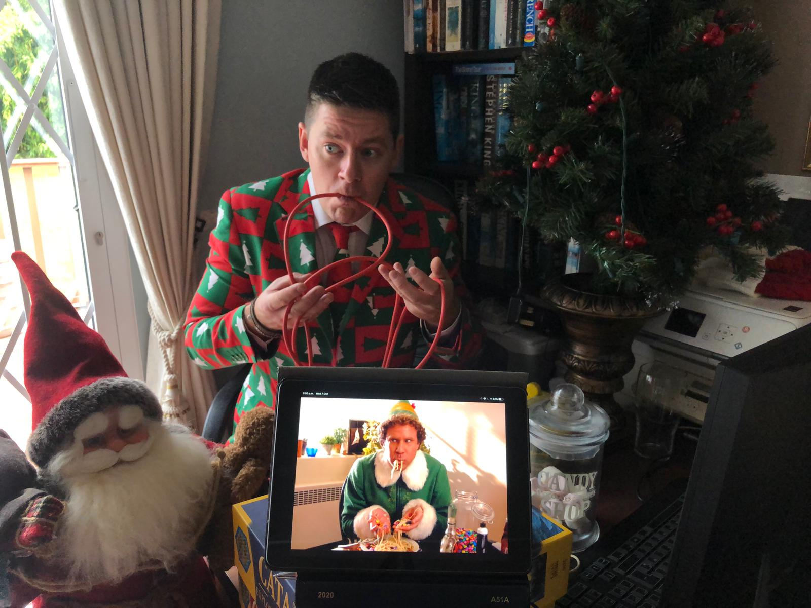 Delegate recreating a famous photo from the movie Elf, as he plays Orangeworks remote corporate Christmas party games.