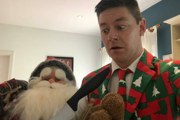 Delegate dressed in festive clothing taking selfies for one of Orangeworks Christmas themed team-building activities.