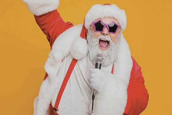 Santa singing into a microphone - Stock Image for Christmas Lip Sync Sing-A-Long